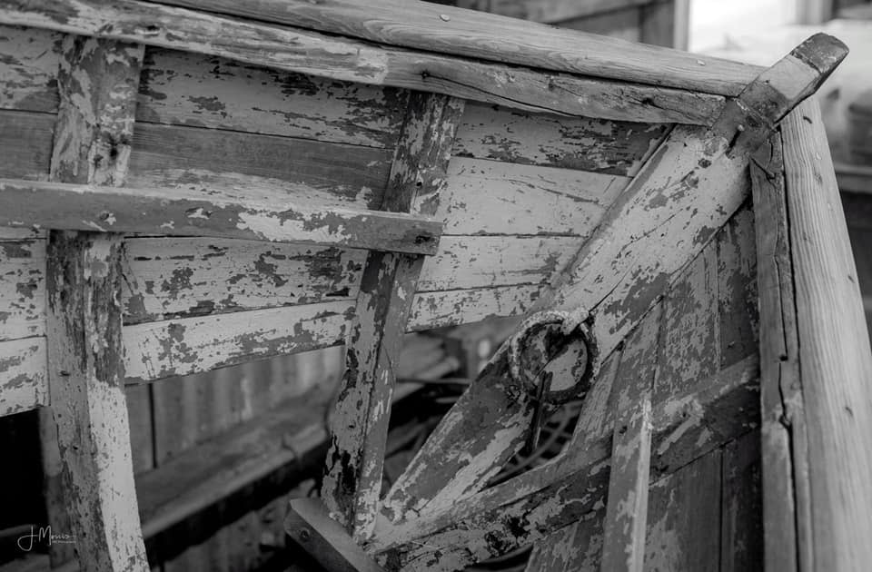 A black and white close up photo of a Farley boat helm.