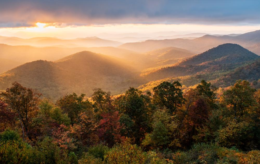A stunning sunrise at the Mills River Valley Overlook on the Blue Ridge Parkway near Asheville, NC