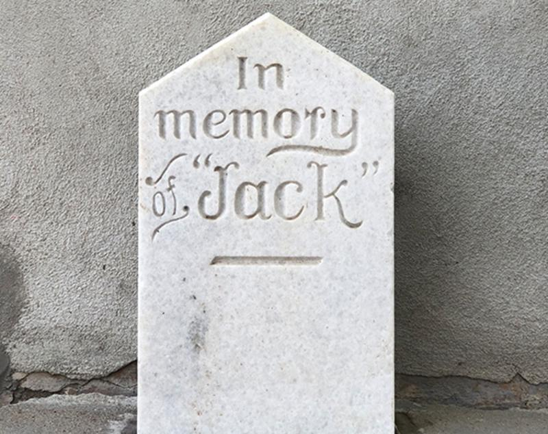 Photo of Jack the Dog's headstone in Downtown San Marcos.