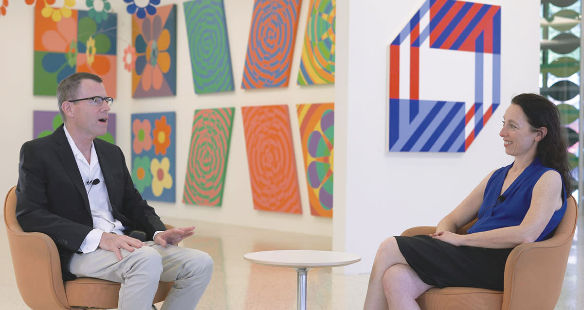 Palm Springs artist Jim Isermann and Palm Springs Art Museum Chief Curator Rochelle Steiner sit on chairs for a discussion.