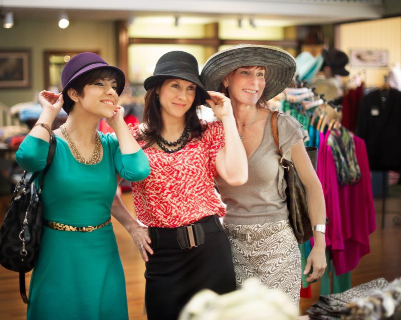Women Try On Hats at Boutique Store In Fredericksburg, TX