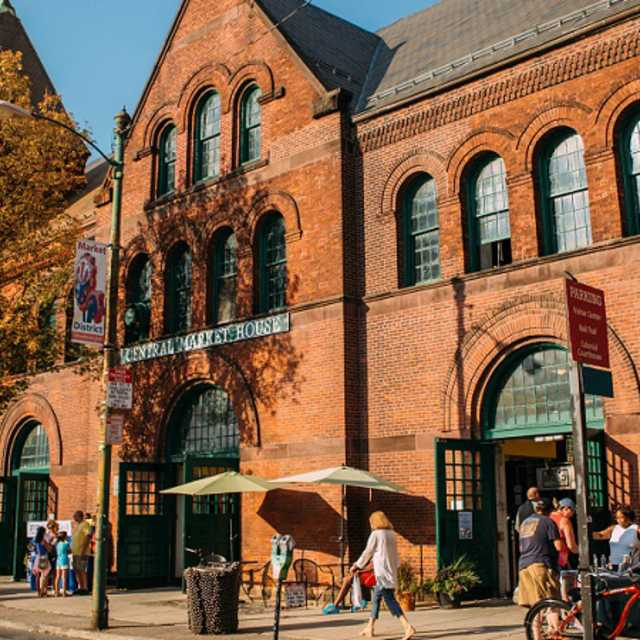 Exterior shot of Central Market House in autumn with people walking along the sidewalk