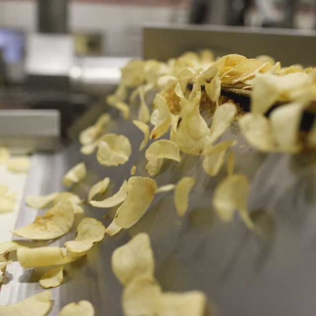 Martin\'s Potato Chips on a conveyor belt