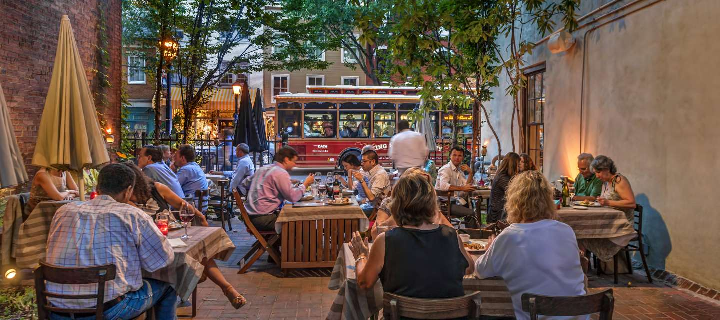 People dining on a patio in Alexandria, VA