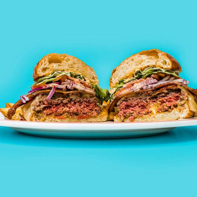 Delicious burger cut in half on a plate on display for Oakland Restaurant Week 2020