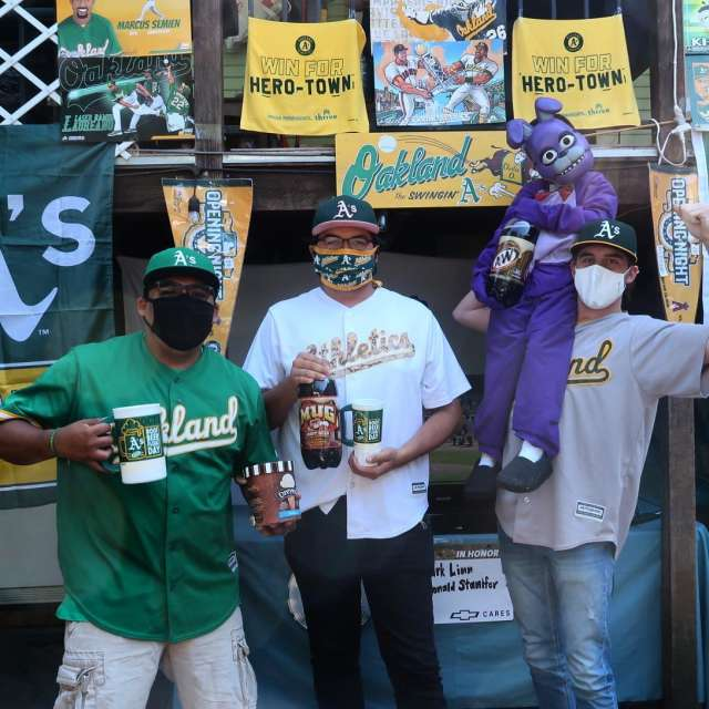 A's Fans posing with masks
