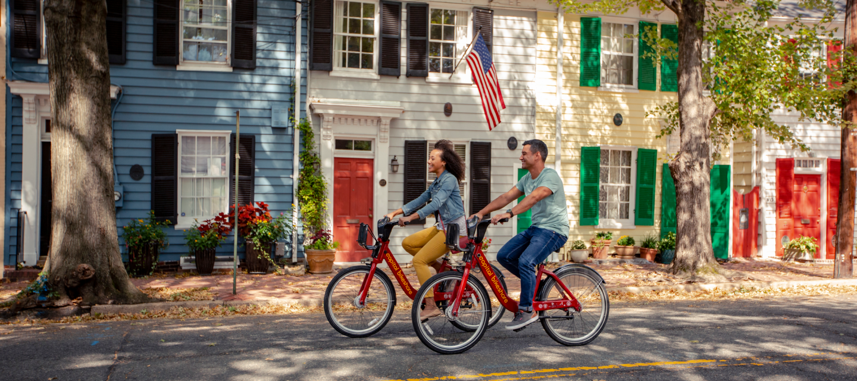 Couple Biking on Queen Street