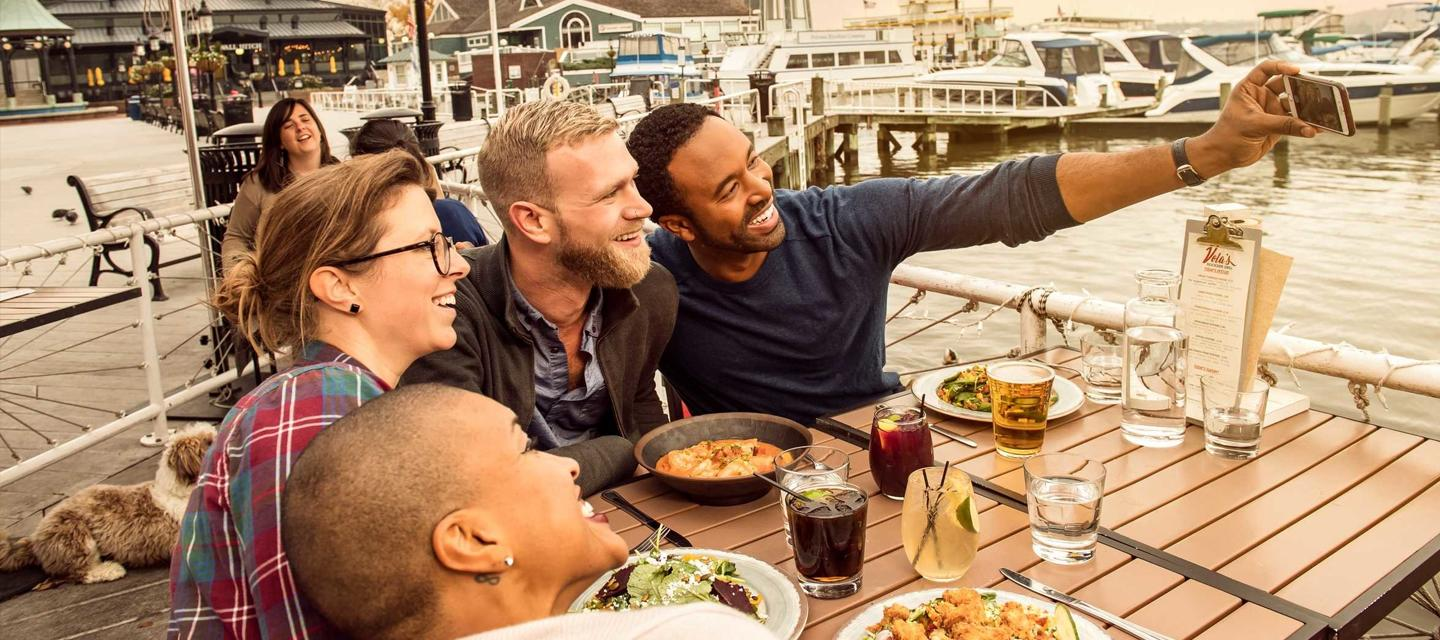 People taking a selfie while patio dining in Alexandria, VA