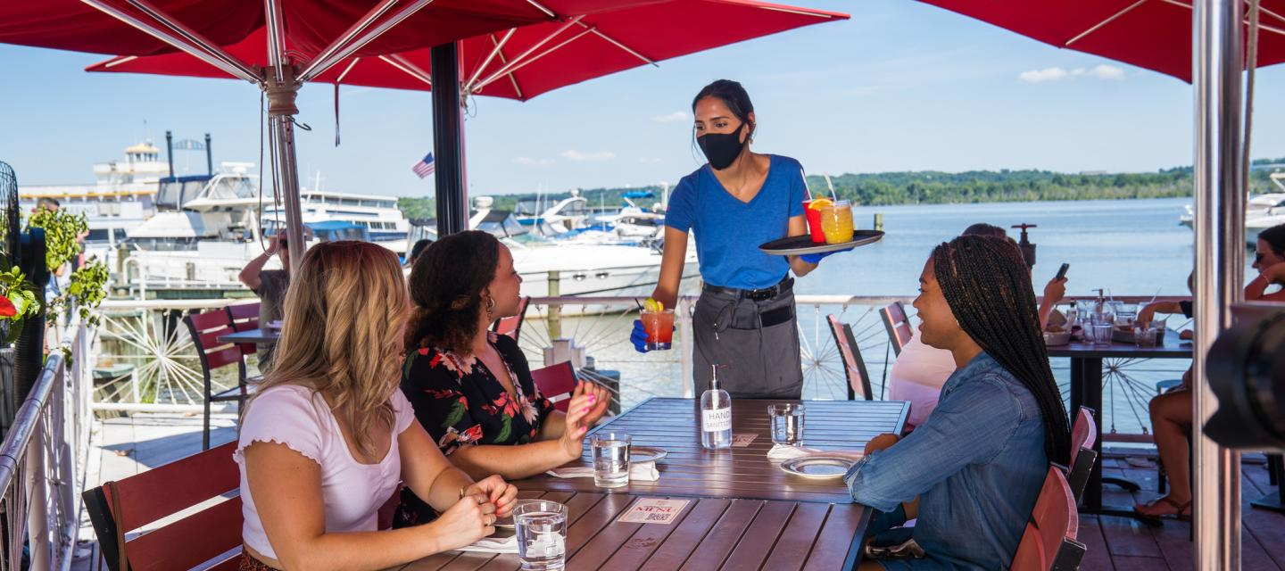 Outdoor Dining with Masked Waitress