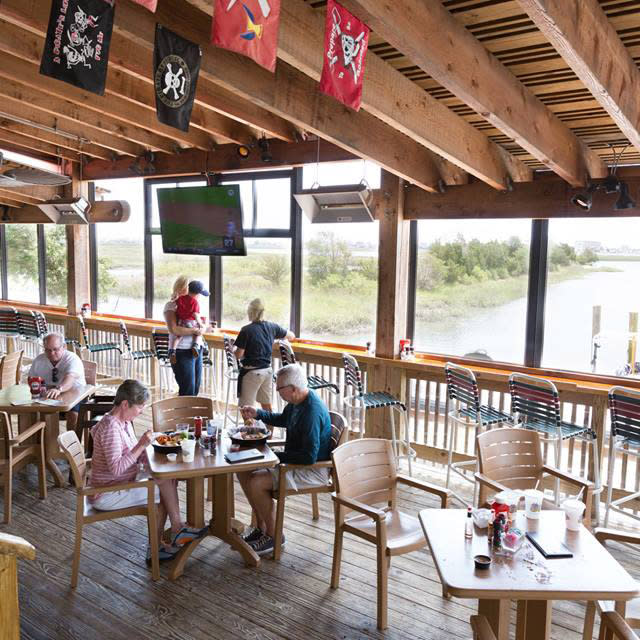 Outdoor dining with view of Inlet at Drunken Jack's