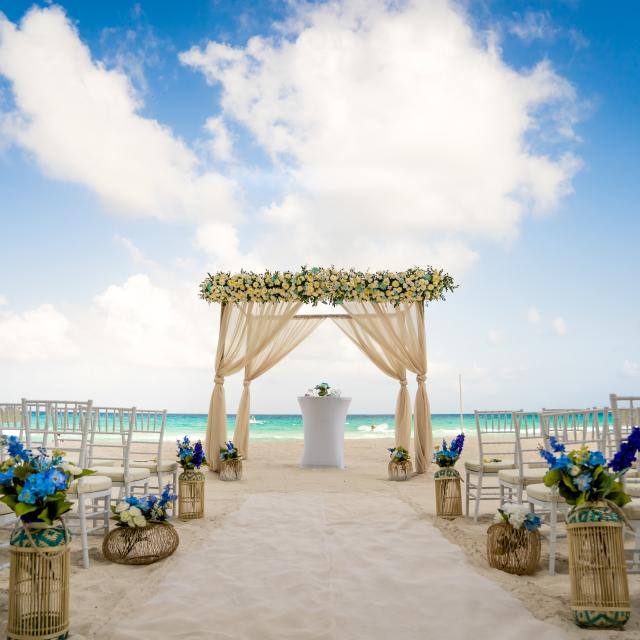 Beach Ceremony Setup with Blue Flowers
