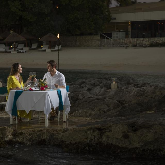 Romantic Dinner with Feet in Water