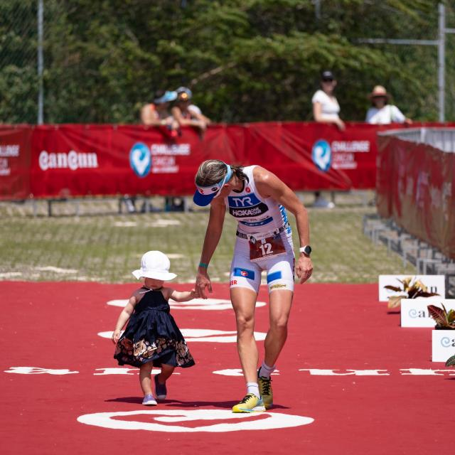 Triathlete Walking with Child