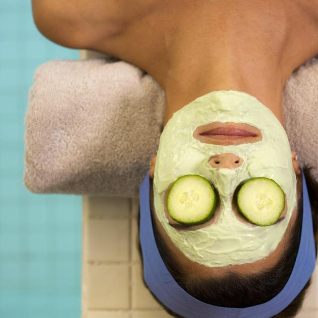 Woman Getting Facial Mask