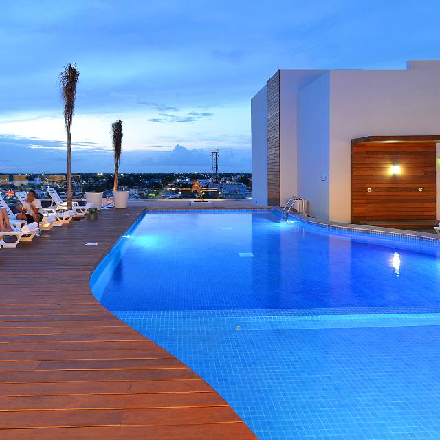 Rooftop Pool and Deck at Sunset