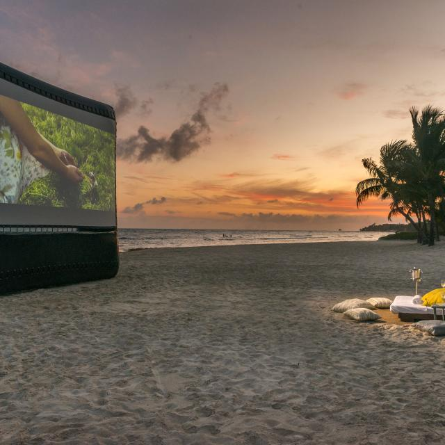 Projector and Chairs on Beach
