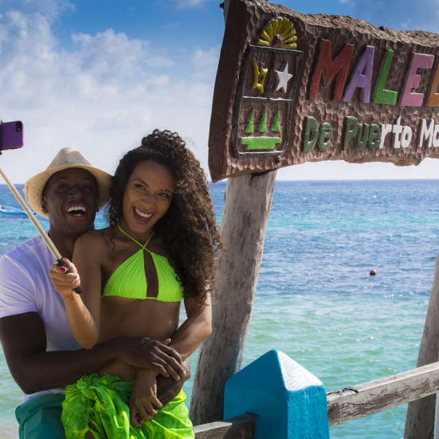 Couple Taking Selfie by Malecon Sign