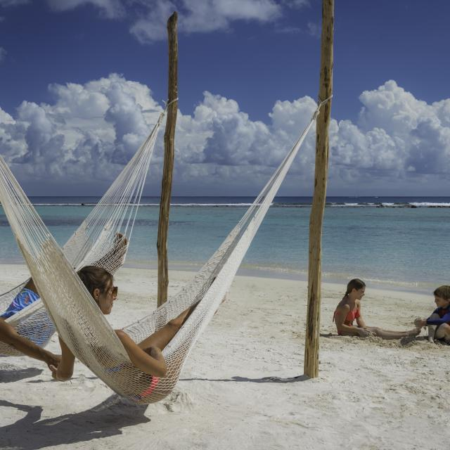 Family in Hammocks on Beach