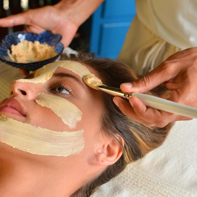 Woman Getting Facial Treatment at Spa