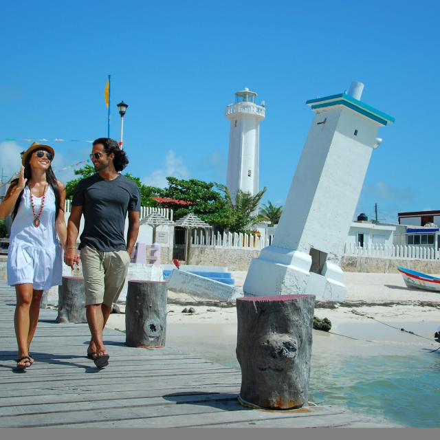 Couple Walking on Pier by Lighthouse