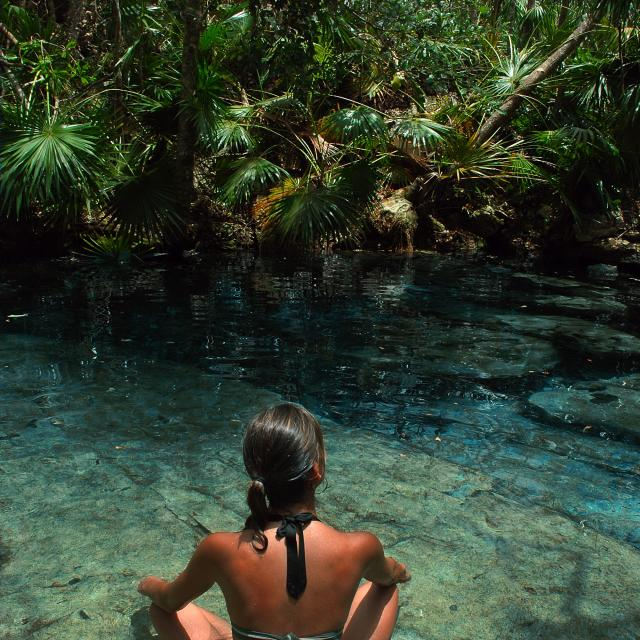 Woman Sitting in Cenote Pool