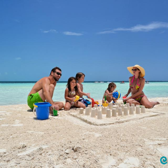 Family Making Sandcastles on Beach