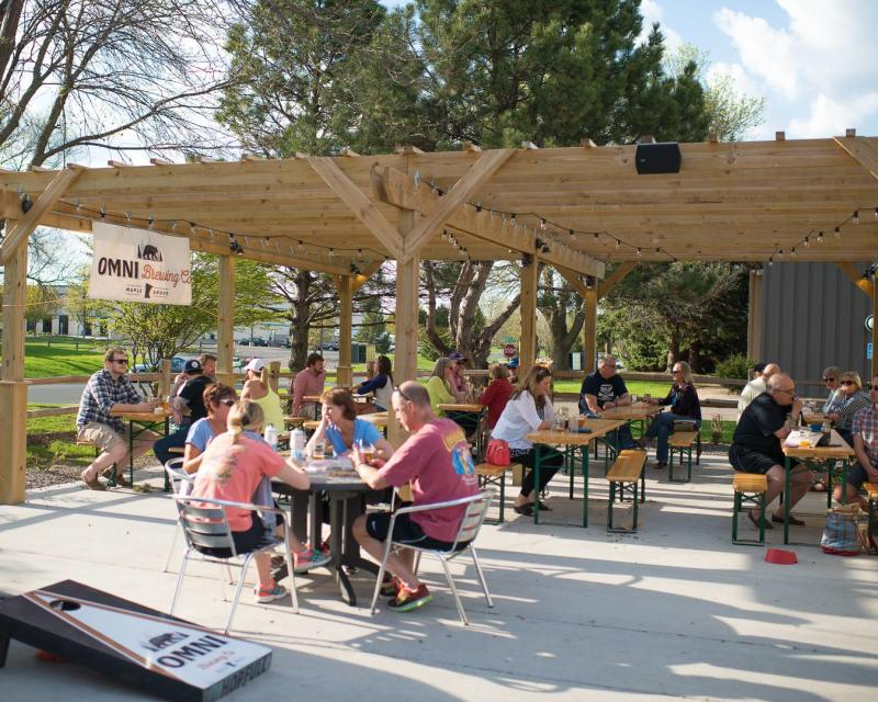 Beer drinkers enjoying the spring day on the OMNI patio