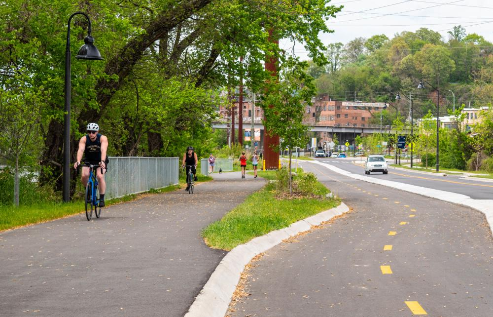 Bicyclists and runners enjoy the new greenway in Asheville's River Arts District