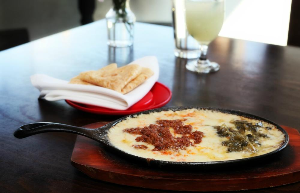 Queso in a skillet with chorizo on top from El Meson Mexican restaurant