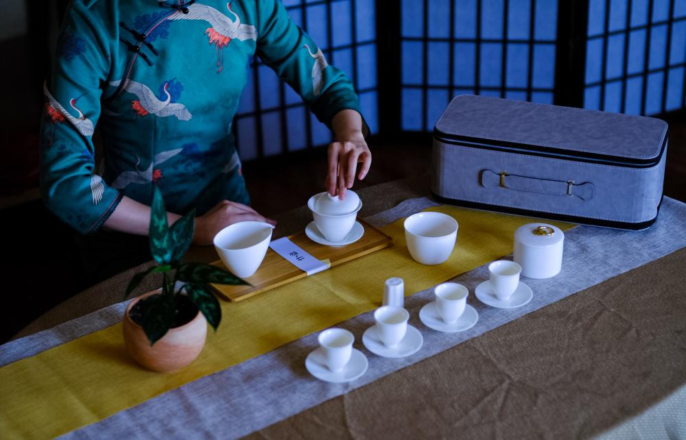 Woman making tea at West China Tea House in Austin Texas