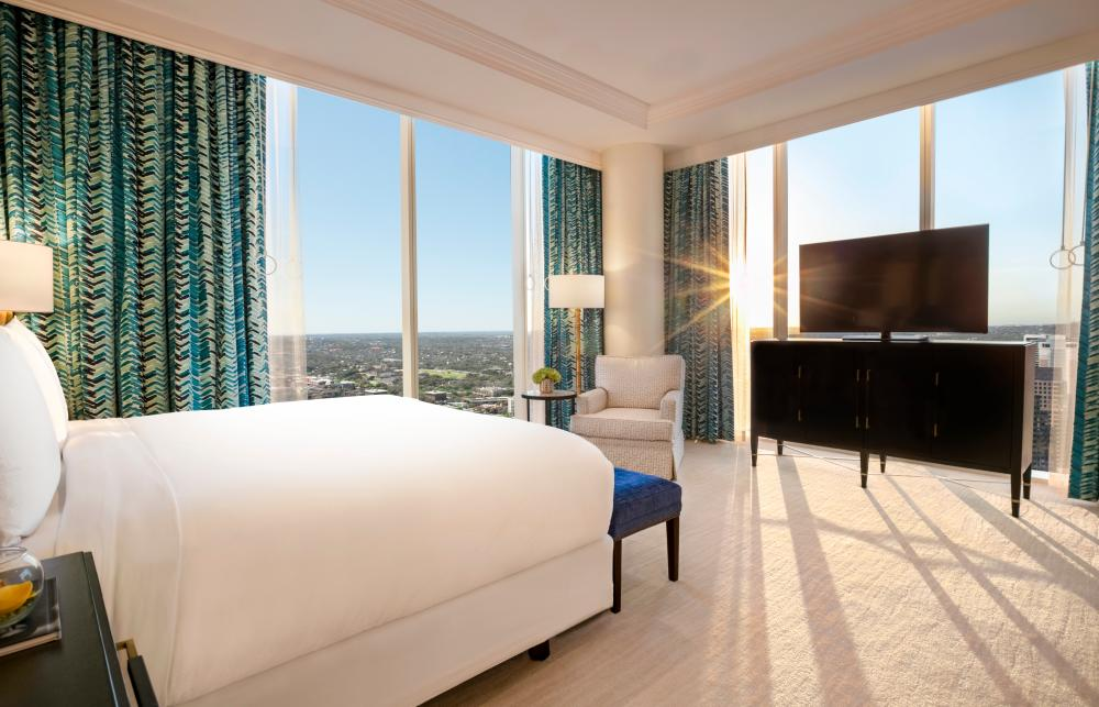 Bed and windows in the Presidential Suite at Fairmont hotel in Austin Texas