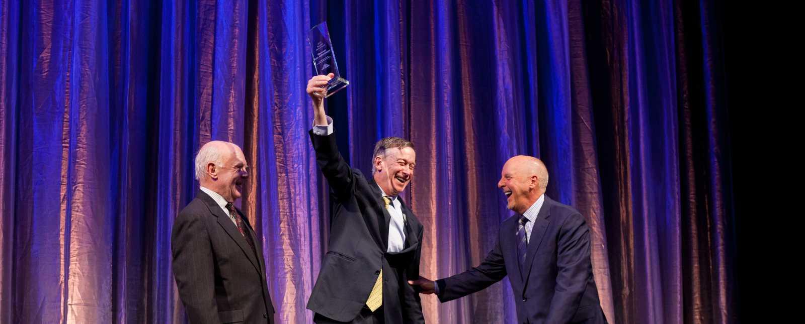 Hickenlooper winning award at 2019 Hall of Fame