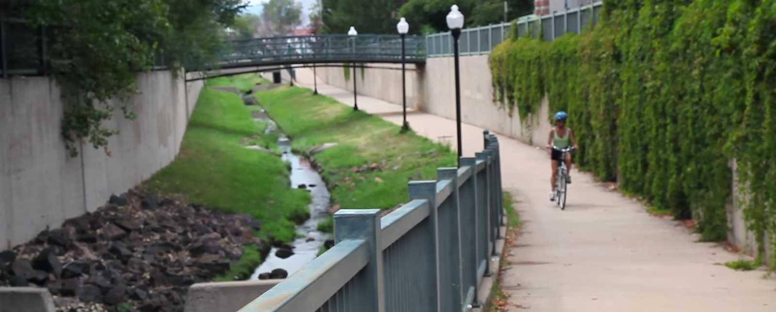 Bicycle rider on bike path in Littleton