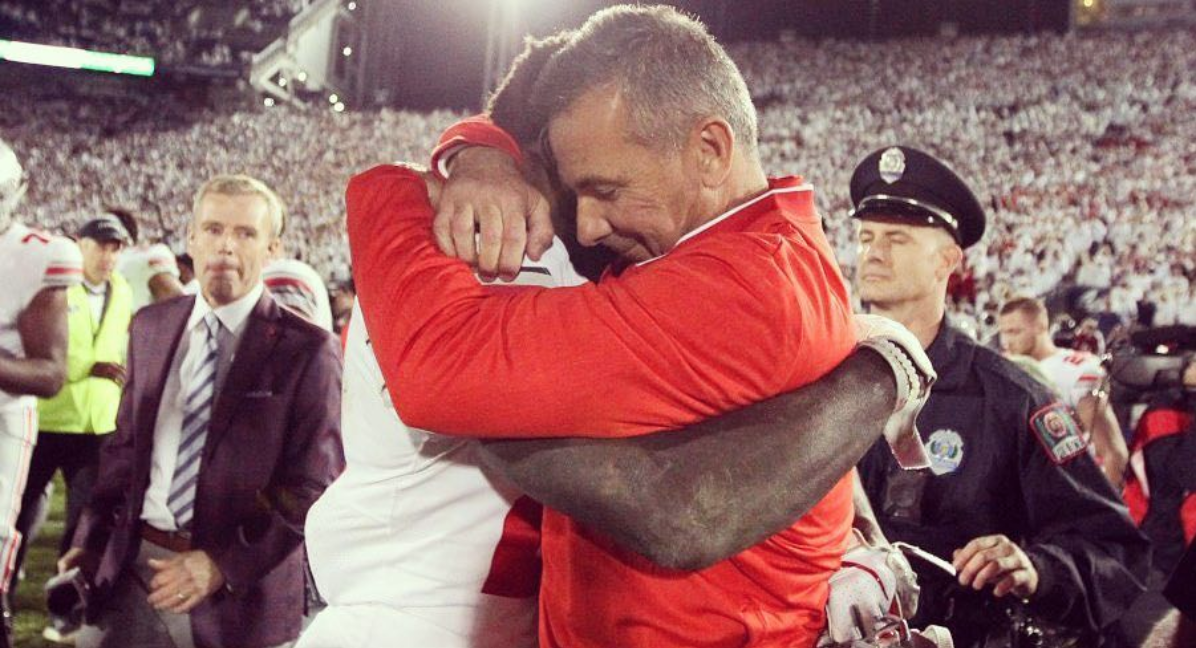 OSU's Urban Meyer and Parris Campbell Jr. embrace following a game