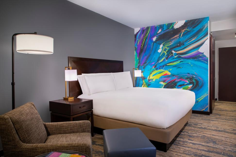 An accent wall mural painted by Jonathan Paul Jackson at the Hilton Americas-Houston hotel