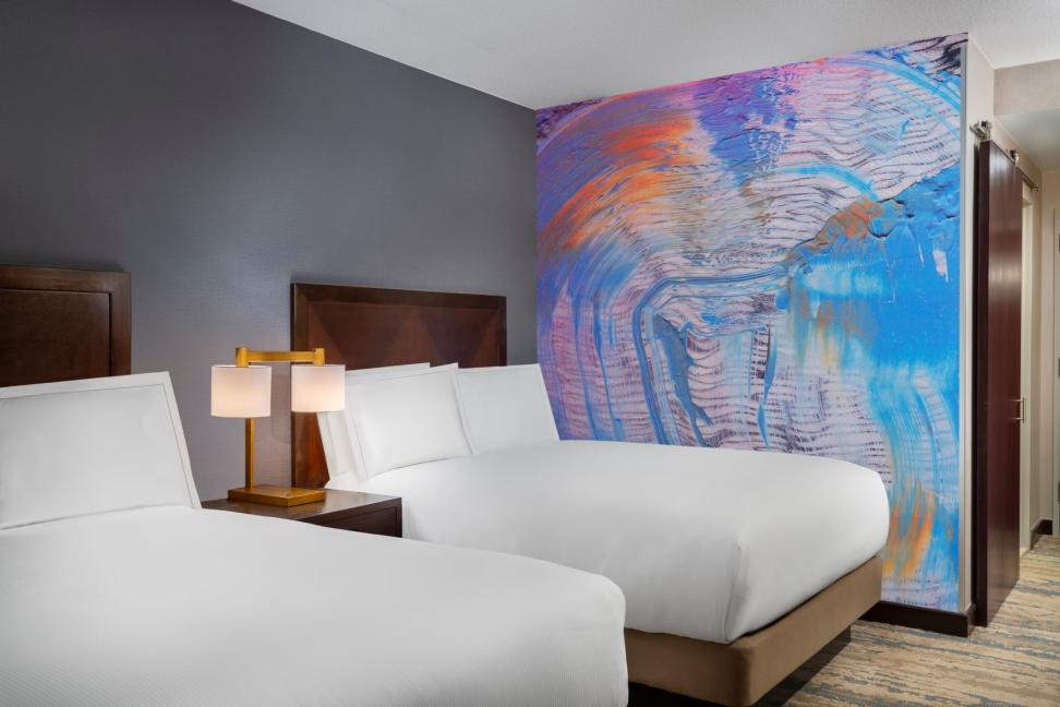 A room at the Hilton Americas-Houston with a mural by Melinda Laszczynski