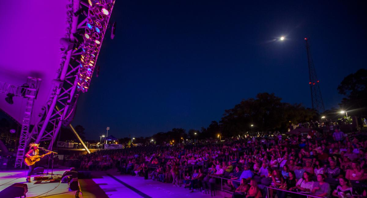 Stage light & moonlight meld during concert at Capital City Amphitheater, Cascades Park, downtown Tallahassee