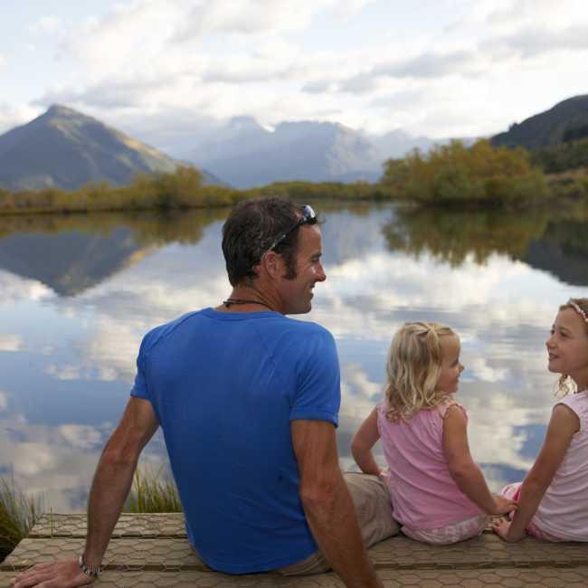 Family walking Mirror Lake Glenorchy