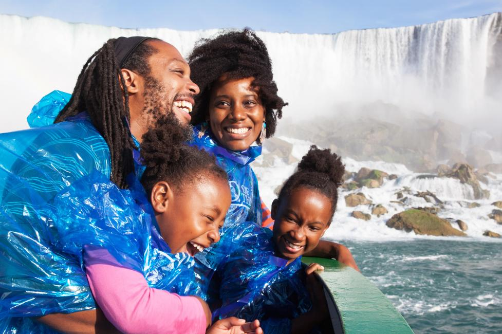 family of four on maid of the mist boat tour