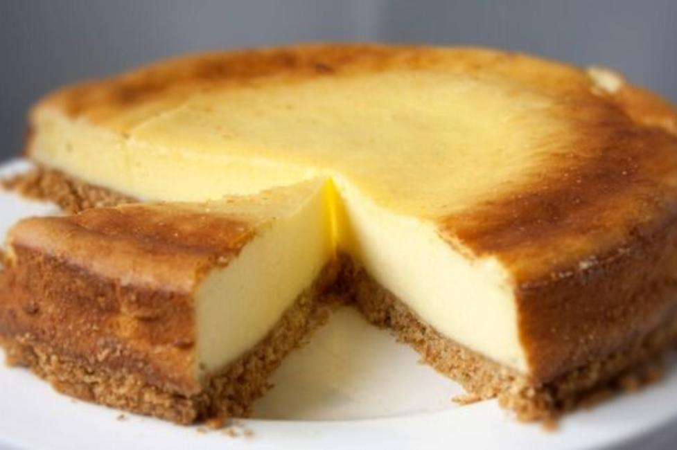 A New York Cheesecake with a few slices cut out