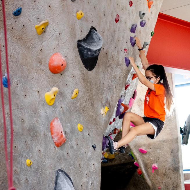 A child on the climbing wall at Boulders Climbing Gym
