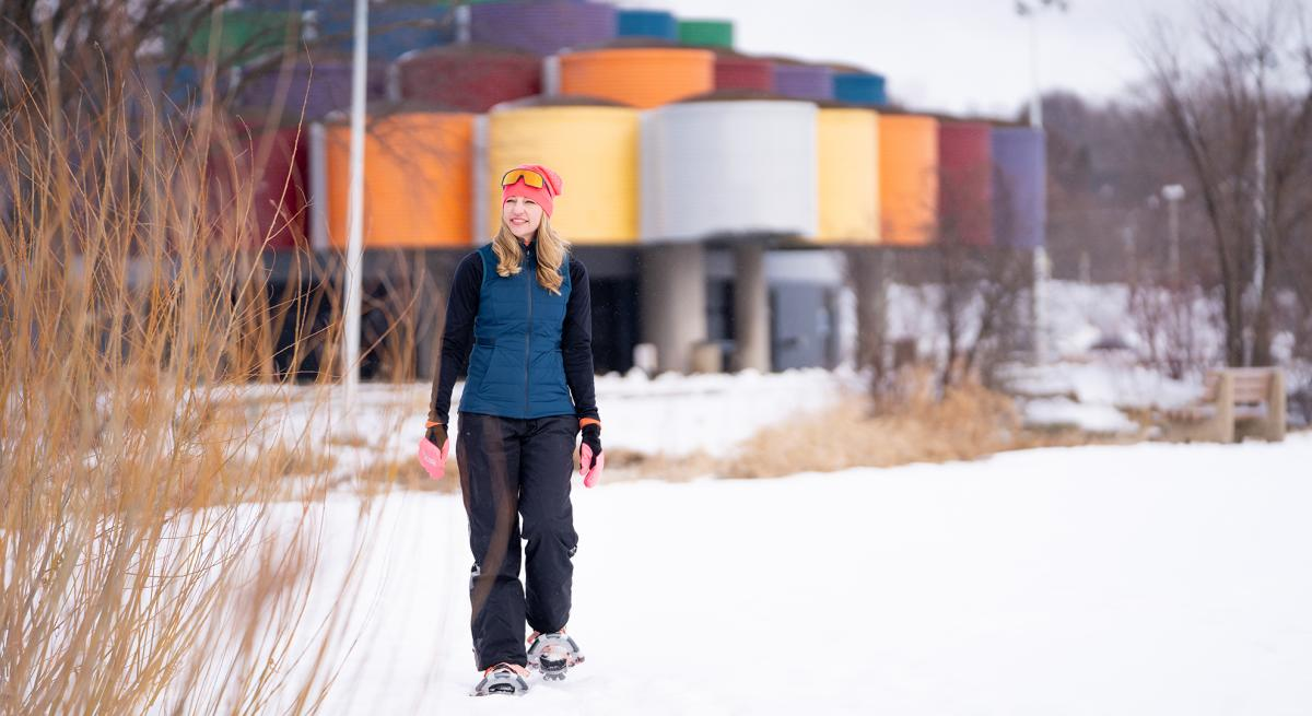 A woman snowshoes on the trails at Warner Park