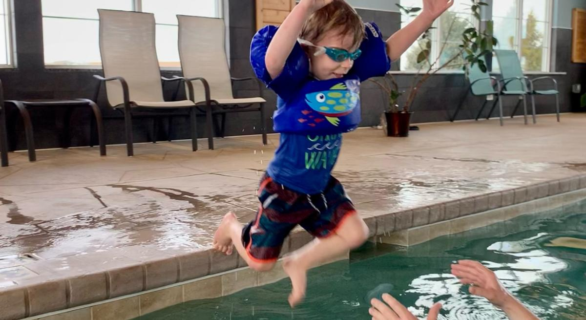 A child jumps into a pool inside of a Madison hotel