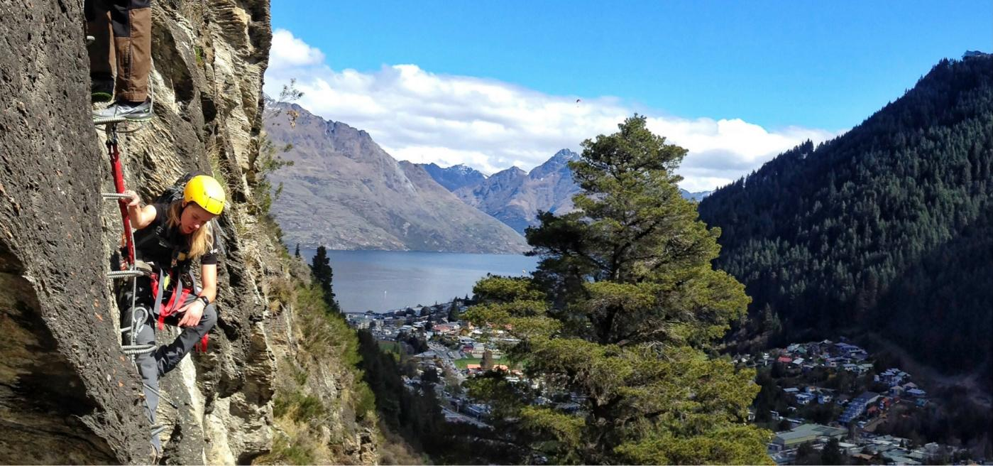 Climbing up Via Ferrata Queenstown with views across Queenstown