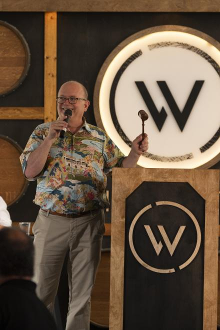 Auctioneer, Fritz Hatton, closes a wine lot at Willamette: The Pinot Noir Auction