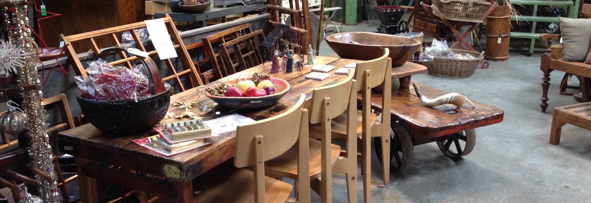 A Table Chairs And Other Home Decor Is Presented In This Warehouse Style Antique