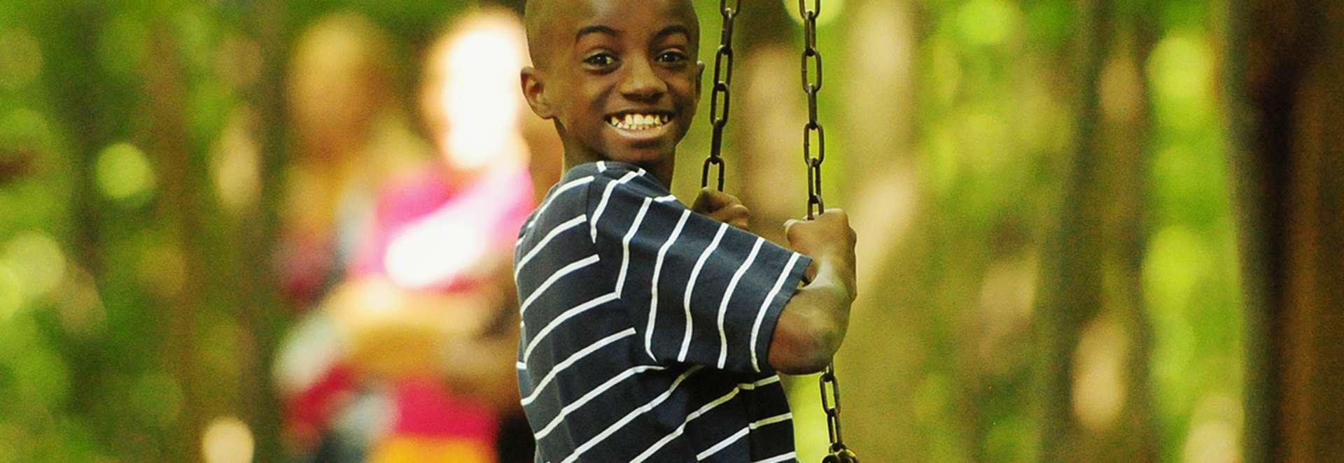 koa-canandaigua-people-boy-smiling-on-zipline