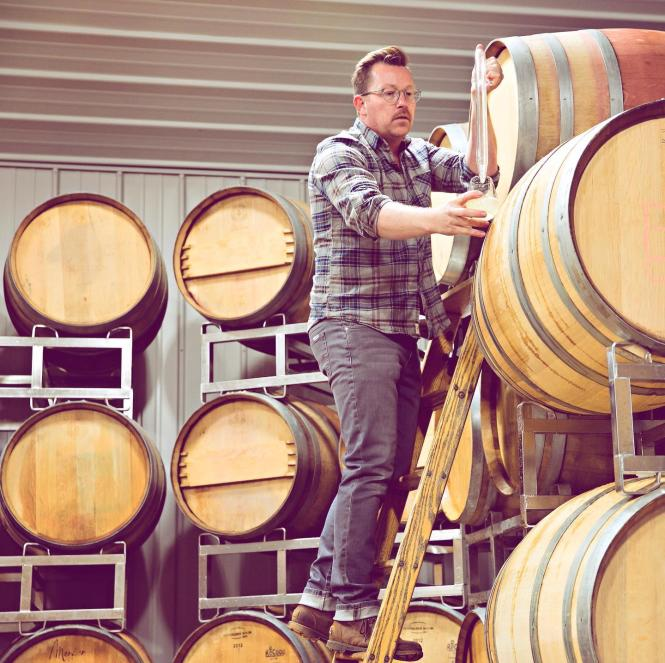 Winemaker and barrels.