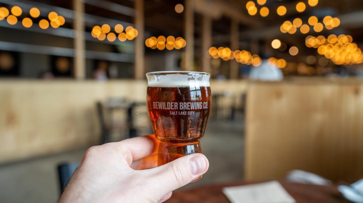 Hand holding a Bewilder beer