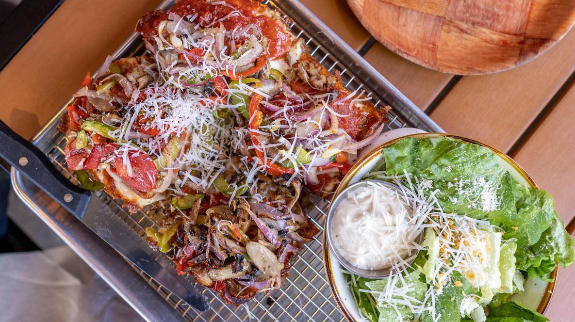 Pizza and salad at Bricks Corner